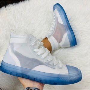 White blue soled sneaker